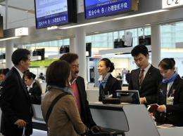 Passengers check in at a counter