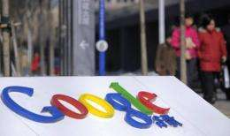 Pedestrians pass the Google logo outside the web titan's Beijing headquarters