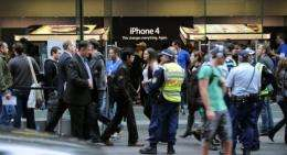 Police stand outside an Apple shop as the iPhone 4 is launched in Sydney