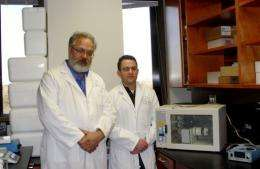 Researcher Nicholas Genovese (R) with biologist Vladimir Mironov in their Charleston research laboratory