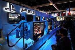 Showgoers try out games at a PlayStation 3 exhibit