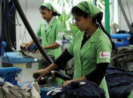 Sri Lankan workers seated inside a green house styled eco factory