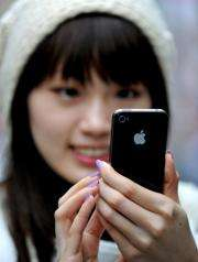 Sydney resident May Tong uses her new Apple iPhone 4