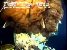 This still image from a live BP video feed shows oil gushing from a leaking BP oil well-pipe on June 5