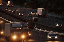 Trucks and cars travel the 10 freeway near Banning, California