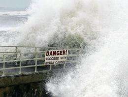 Waves slam over a seawall in Jupiter, Florida, during a hurricane