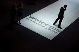A man walks past an IBM