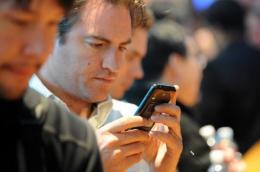 An attendee looks at a Motorola Atrix smartphone
