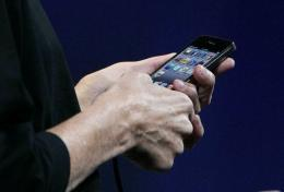 Apple CEO Steve Jobs demonstrates the new iPhone 4