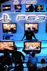 Attendees play video games at a Sony Playstation booth