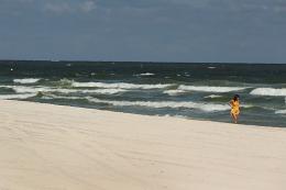 A woman walks the beach in Gulf Shores, Alabama, in 2010