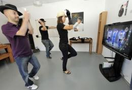 French videogame company Ubisoft employees play a video game called