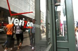 People walk by a Verizon store in New York