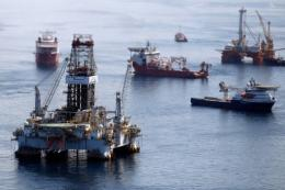 Ships work near the site of the BP Deepwater Horizon oil spill in the Gulf of Mexico in August 2010