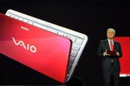 Sir Howard Stringer shows a pocket-sized Sony Vaio computer