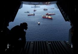 Vessels work at the site of the Deepwater Horizon accident as viewed from inside a Coast Guard flight over the site
