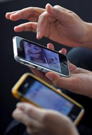 Women use iPhone mobile phones