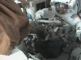 Astronauts tackling antenna work in 1st spacewalk (AP)