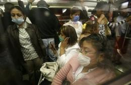 1 year after swine flu, Mexicans split on response (AP)