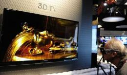 A man looks at the Sharp Aquos Quattron 3D television display