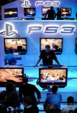 Attendees play video games at the Sony Playstation booth