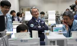 JAXA personnel celebrate after a Hayabusa spacecraft probe lands in Australia