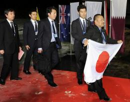 Members of the Japanese delegation arrive to the FIFA headquarters in Zurich