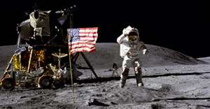 Young salutes the American flag next to the lunar module Orion during the Apollo 16 mission in 1972