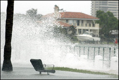 Waves from Hurricane Rita crash over a seawall in Miami, Florida