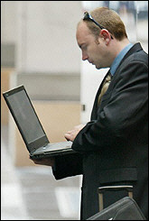 A businessman uses his laptop computer