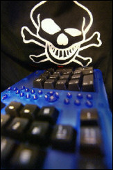 Skull and crossbones above a keyboard