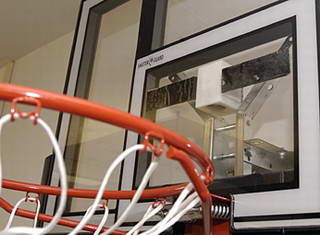 The white box behind the backboard houses a sound emitter that helps the player hear where the shooting target is located