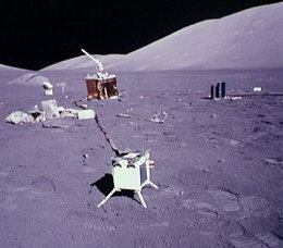 The box in the foreground is the Lunar Ejecta and Meteorites Experiment (LEAM).