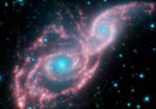 Galaxies Don Mask of Stars in New Spitzer Image
