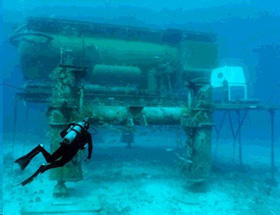 A diver approaches the Aquarius undersea research laboratory