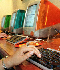 A row of Apple computers at a cybercafe