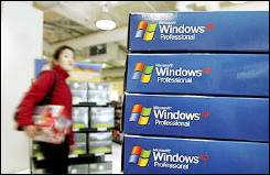A customer walks near a display of Microsoft Windows XP software