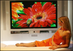 A Panasonic employee presents a huge 103-inch plasma TV screen