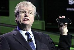 Howard Stringer holds up a PlayStation Portable