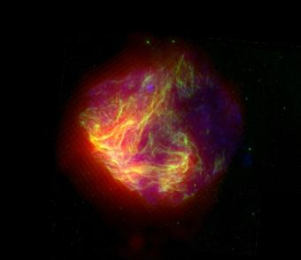 This false-color image shows infrared (red), optical (green), and X-ray (blue) views of the N49 supernova remnant