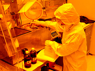 A student learns clean room processes necessary for nanotechnology as part of the NNIN's Research Experience for Undergraduates