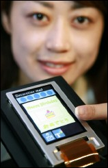A Sharp employee demonstrates how to send an e-mail with a touch screen