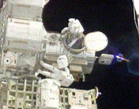 Atlantis Spacewalkers Work to Activate Truss