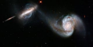 Hubble sees the graceful dance of 2 interacting galaxies