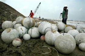 Indonesia Drops Balls Into Volcano (AP)