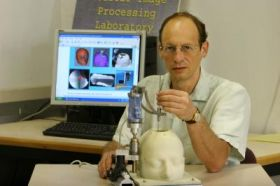 Miniature robot for precise positioning and targeting in neurosurgery wins award