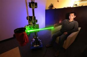 Researchers Show Off Laser-Guided Robot (AP)