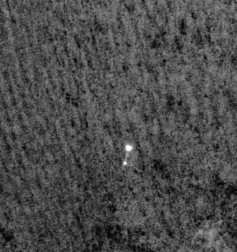 Camera on Mars Orbiter Snaps Phoenix During Landing