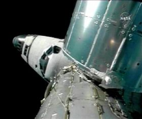 Spacewalk on Despite Robot Trouble (AP)