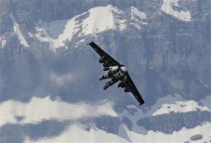 Swiss man soars above Alps with jet-powered wing (AP)